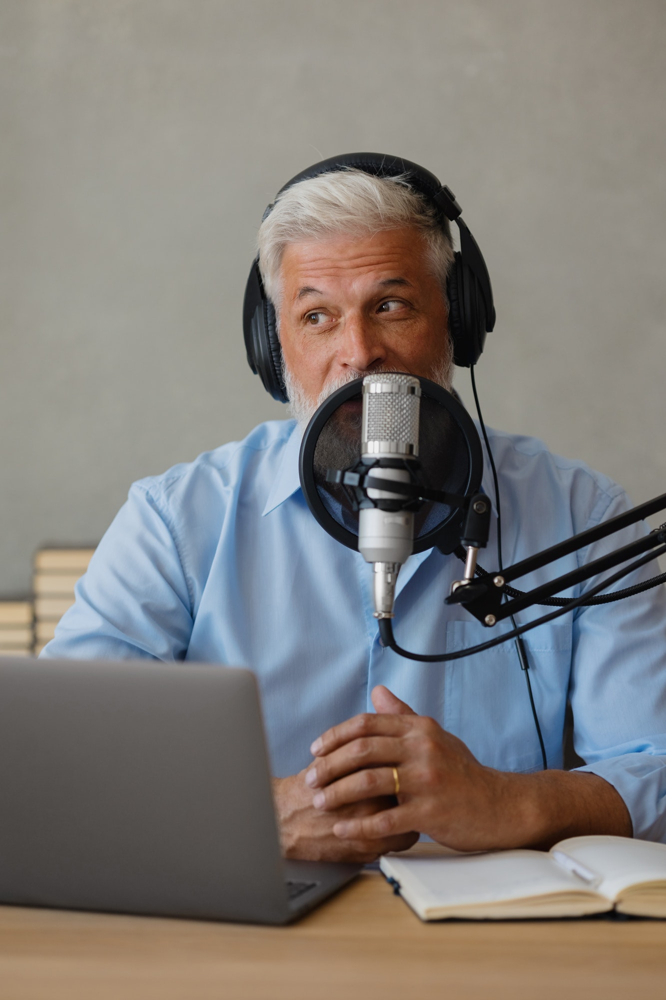male podcaster in blue shirt, happy seniors recording their voice for an audio book